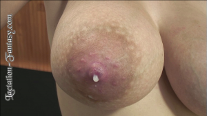 a close up view of a breast full of milk and leaking milk