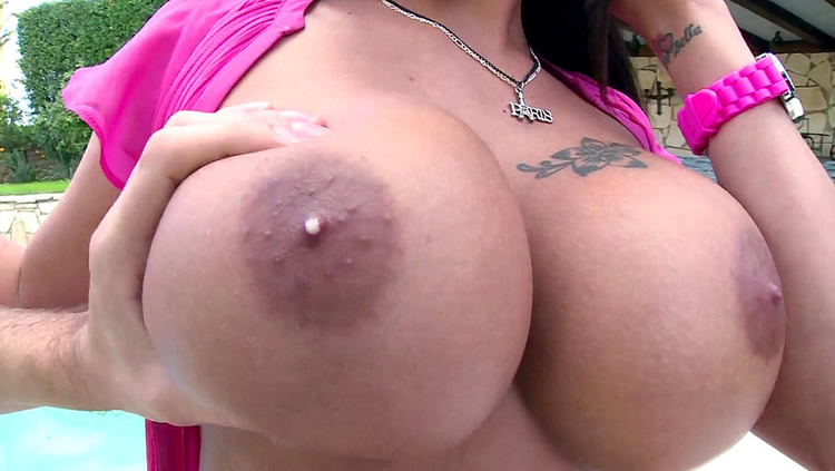 big fat full tits dripping milk from dark areolas